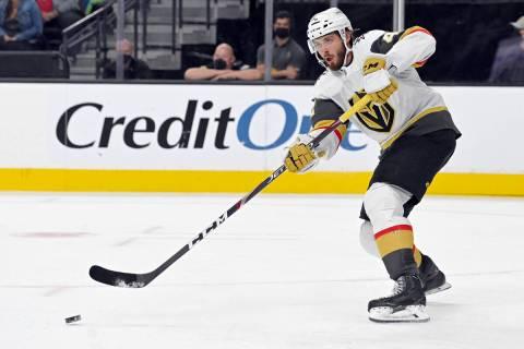 Vegas Golden Knights defenseman Daniil Miromanov hits the puck against the Los Angeles Kings du ...