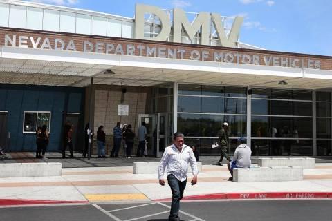 A customer walks past the DMV at Sahara office on Friday, May 10, 2019, in Las Vegas. (Bizuayeh ...