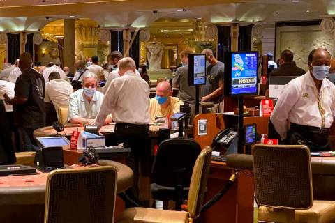 Gamblers don protective face masks at Caesars on the Strip in Las Vegas Wednesday, June 24, 202 ...