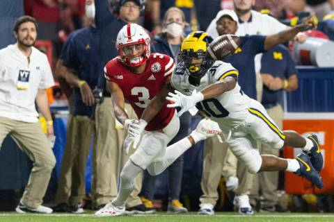 Michigan defensive back Daxton Hill (30) knocks away a pass intended for Nebraska wide receiver ...