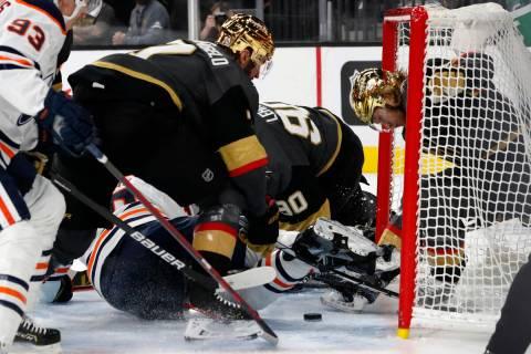 Edmonton Oilers left wing Zach Hyman, bottom, scores as Vegas Golden Knights center William Kar ...