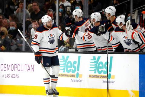 Edmonton Oilers center Leon Draisaitl (29) is congratulated by teammates after scoring during t ...