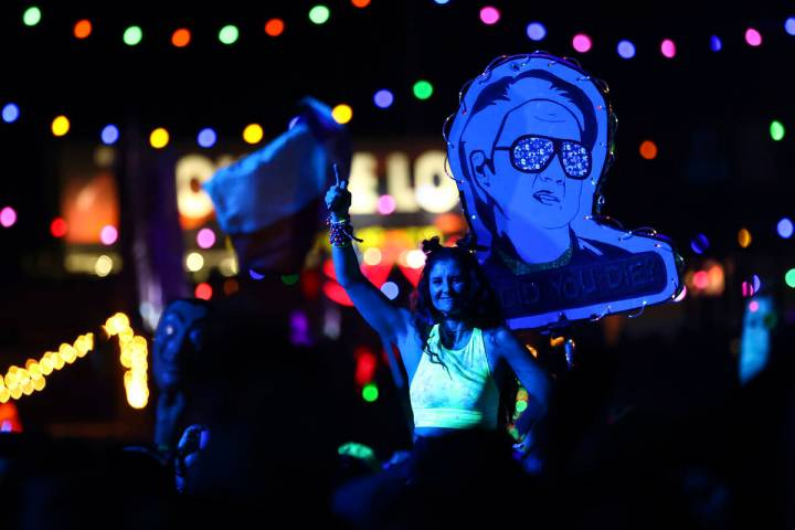 People dance as Kaskade performs at the Kinetic Field stage during the final day of the Electri ...