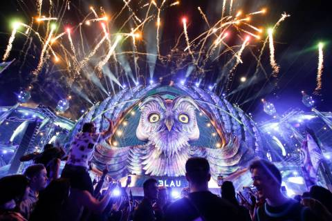 Fireworks light up the stage as DJ 3Lau performs at the Kinetic Field stage during the final da ...