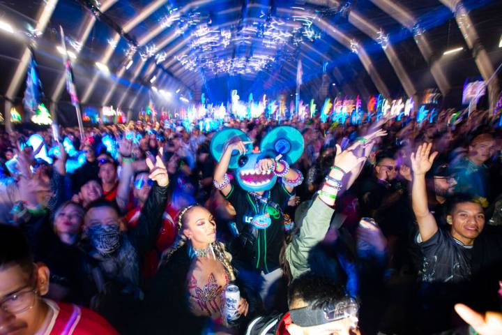 Attendees dance as Enrico Sangiuliano performs at the Neon Garden stage during the Electric Dai ...