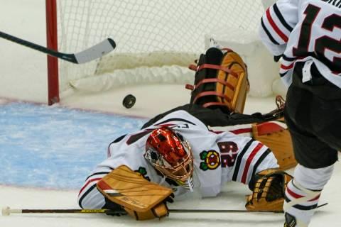 Chicago Blackhawks goaltender Marc-Andre Fleury (29) plays in an NHL hockey game against the Pi ...