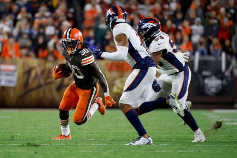 Cleveland Browns running back D'Ernest Johnson (30) runs with the ball during an NFL football g ...