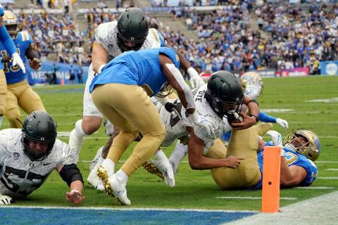 Oregon running back Travis Dye is stopped just short of the goal line during the first half of ...