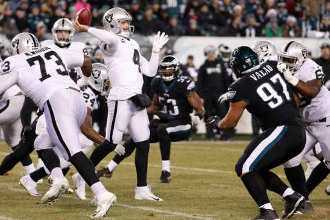 Oakland Raiders' Derek Carr passes during the first half of an NFL football game against the Ph ...