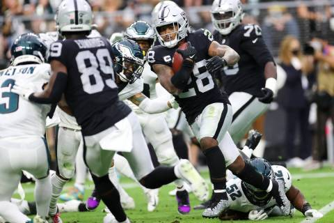 Raiders running back Josh Jacobs (28) runs the ball against the Philadelphia Eagles during the ...