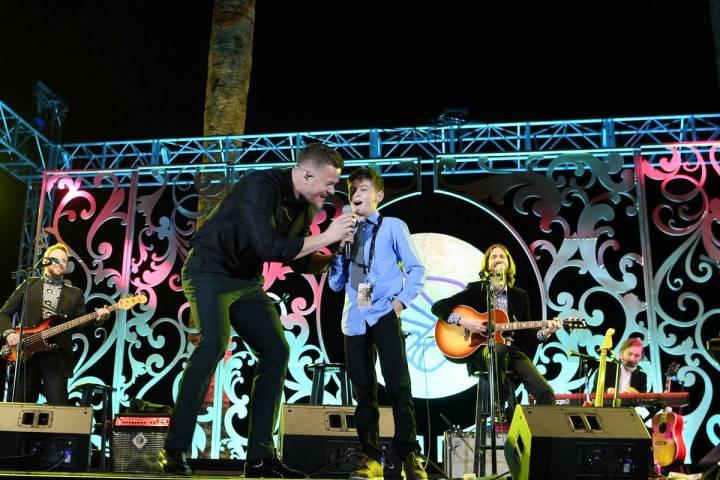 Cooper Sandoval, 12, and Imagine Dragons singer Dan Reynolds perform at Imagine Dragons' sevent ...