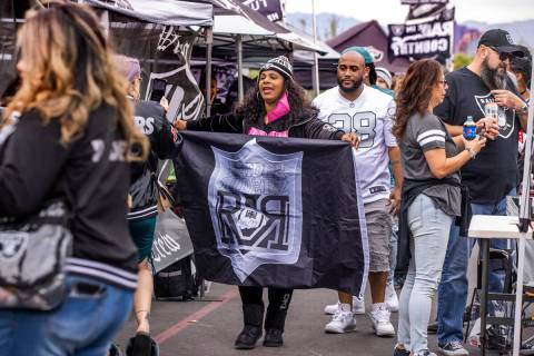 The Raider Riders from Los Angeles parade through tailgating before the first half of an NFL ga ...