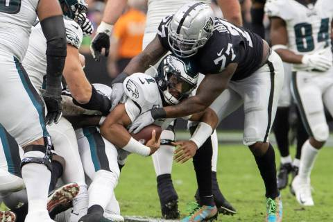 Philadelphia Eagles quarterback Jalen Hurts (1) is sacked by Raiders defensive tackle Quinton J ...