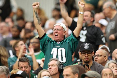 Philadelphia Eagles fans cheer during the first half of an NFL football game against the Raider ...