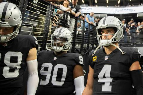 Raiders quarterback Derek Carr (4) waits to lead his team onto the field before the start of an ...