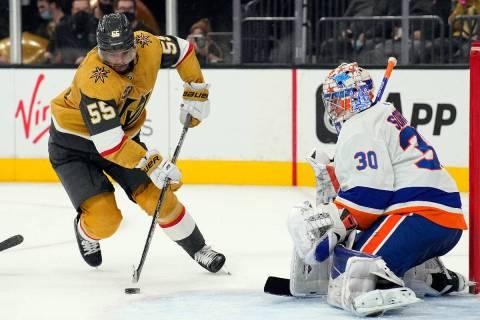 Golden Knights Keegan Kolesar tries to score on New York Islanders goaltender Ilya Sorokin (30) ...