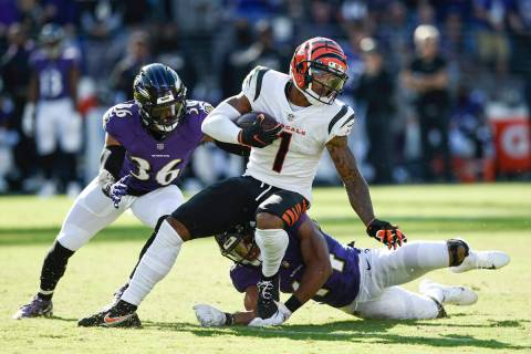 Baltimore Ravens safety Chuck Clark (36) and cornerback Marlon Humphrey (44) miss a tackle of C ...