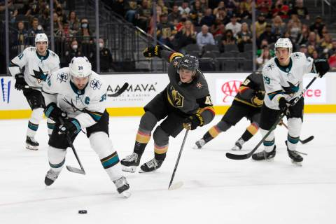 Sharks center Logan Couture (39) and Golden Knights forward Nolan Patrick (41) skate for the pu ...