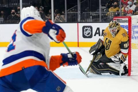Vegas Golden Knights goalie Robin Lehner (90) makes a save against New York Islanders left wing ...