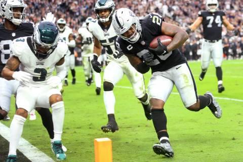 Raiders running back Josh Jacobs (28) runs the ball for a touchdown against the Philadelphia Ea ...