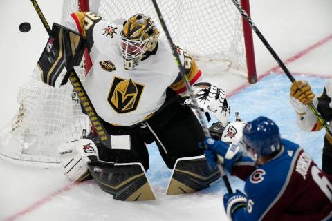 Vegas Golden Knights goalie Robin Lehner, left, deflects a shot off the stick of Colorado Avala ...