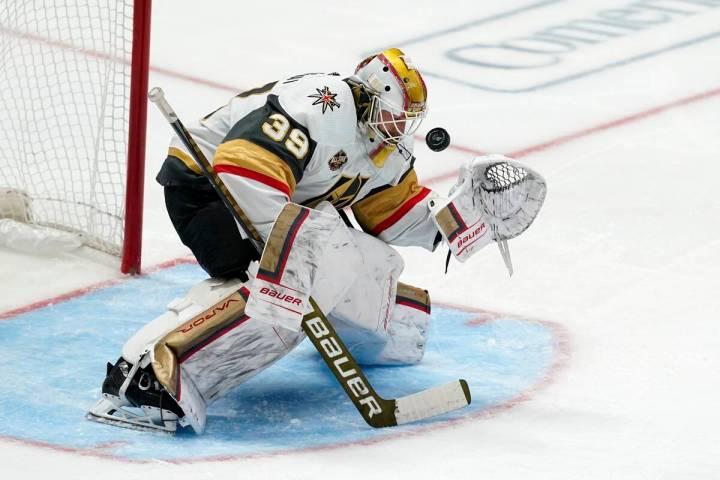 Vegas Golden Knights goaltender Laurent Brossoit has a shot from the Dallas Stars deflect off h ...
