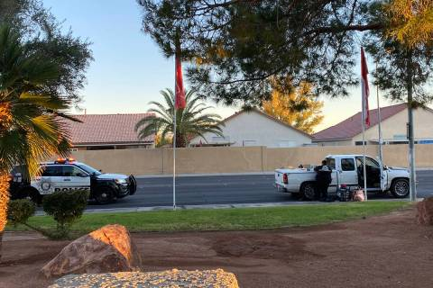 Las Vegas police process a vehicle on East Harmon Avenue early Tuesday. The vehicle was located ...