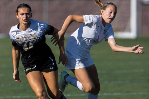 Faith Lutheran's Ari Gaminara, left, and Arbor View's Zoey Christian fight for possession d ...