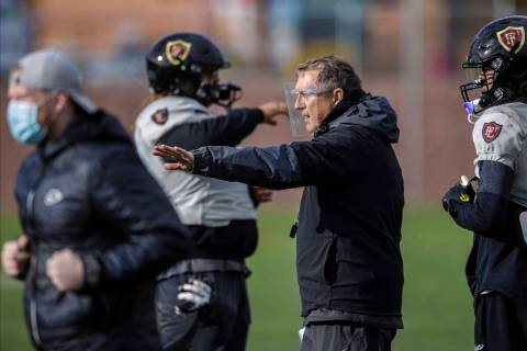 In this March 11, 2021, file photo, Faith Lutheran head football coach Mike Sanford leads pract ...