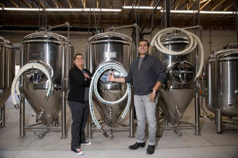 Amanda Payan, left, and her brother, Matt, co-owners of North 5th Brewing Co., pose for a portr ...
