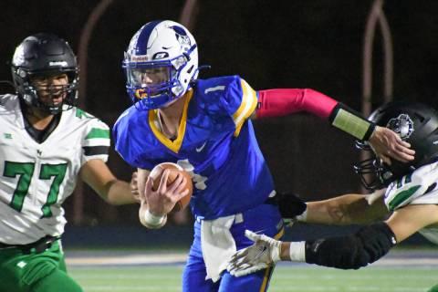 Moapa Valley quarterback Peyton Neilson avoids a sack during the Hammer Game against Virgin Val ...