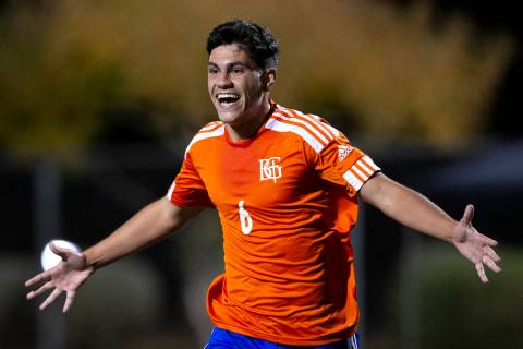 Bishop Gorman's Joseph Chami (6) runs to celebrate with his team after scoring a goal against L ...
