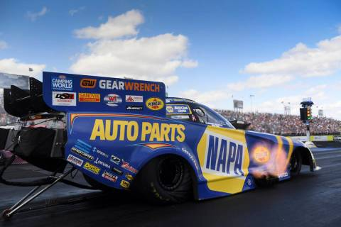 In this photo provided by the NHRA, Funny Car's Ron Capps drives to the win in the final round ...